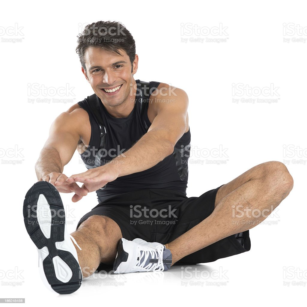 Happy Young Man Stretching stock photo