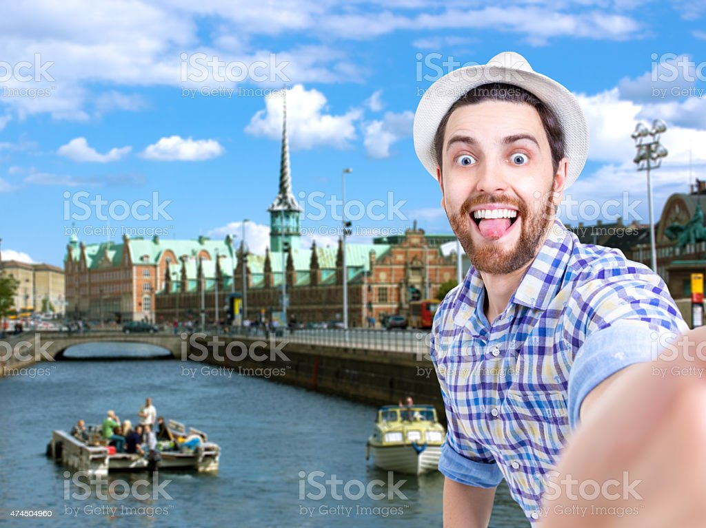 Happy young man taking a selfie photo in Copenhagen, Denmark stock photo