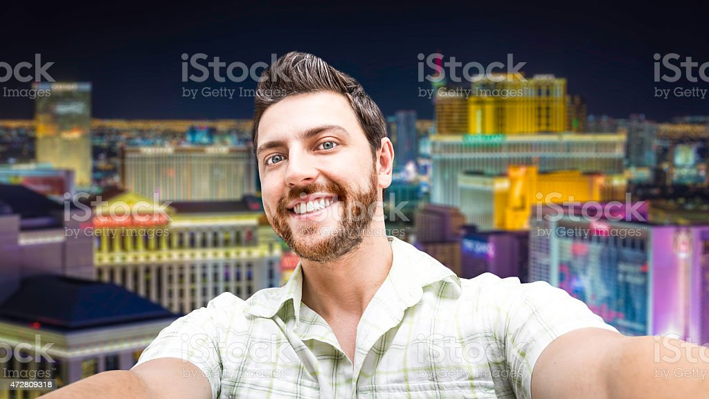 Happy young man taking a selfie photo in Las Vegas stock photo