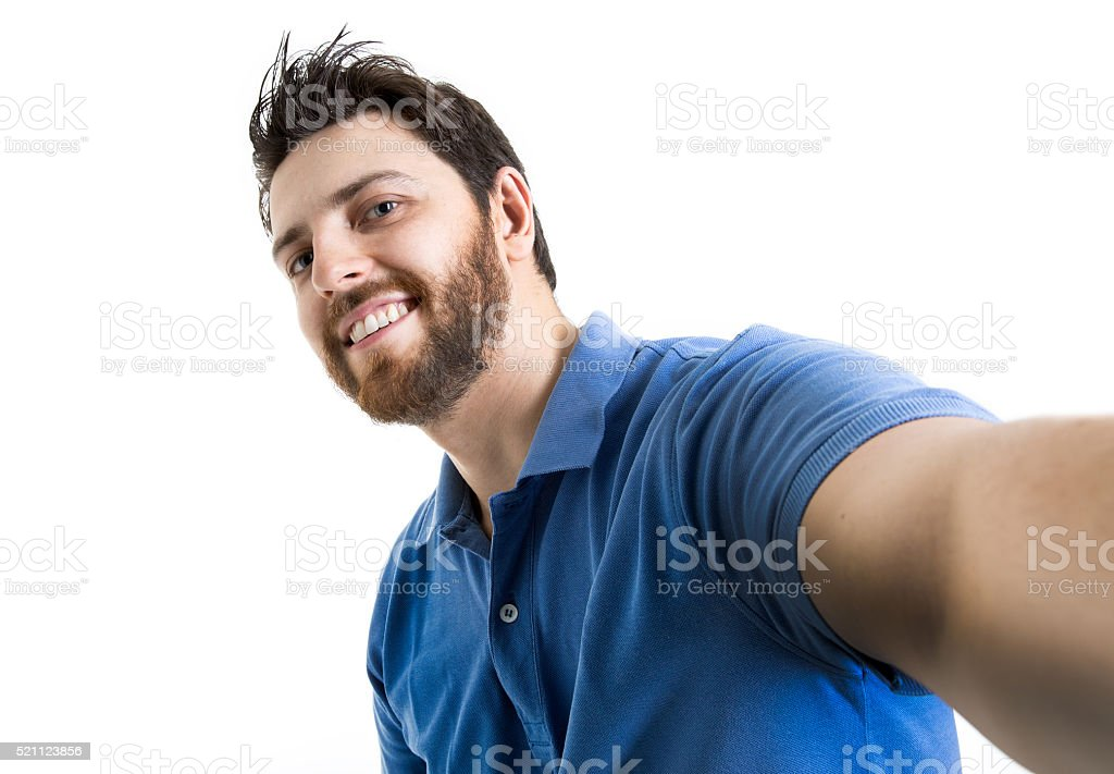 Happy young man taking a selfie photo on white background stock photo