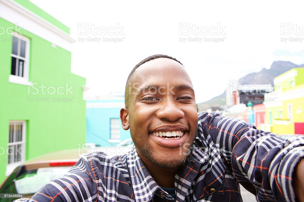 Happy young man taking a selfie stock photo