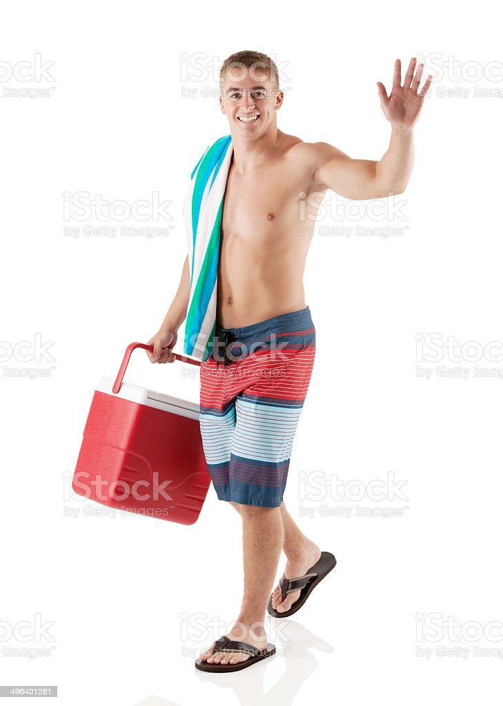 Happy young man walking with cooler and waving royalty-free stock photo