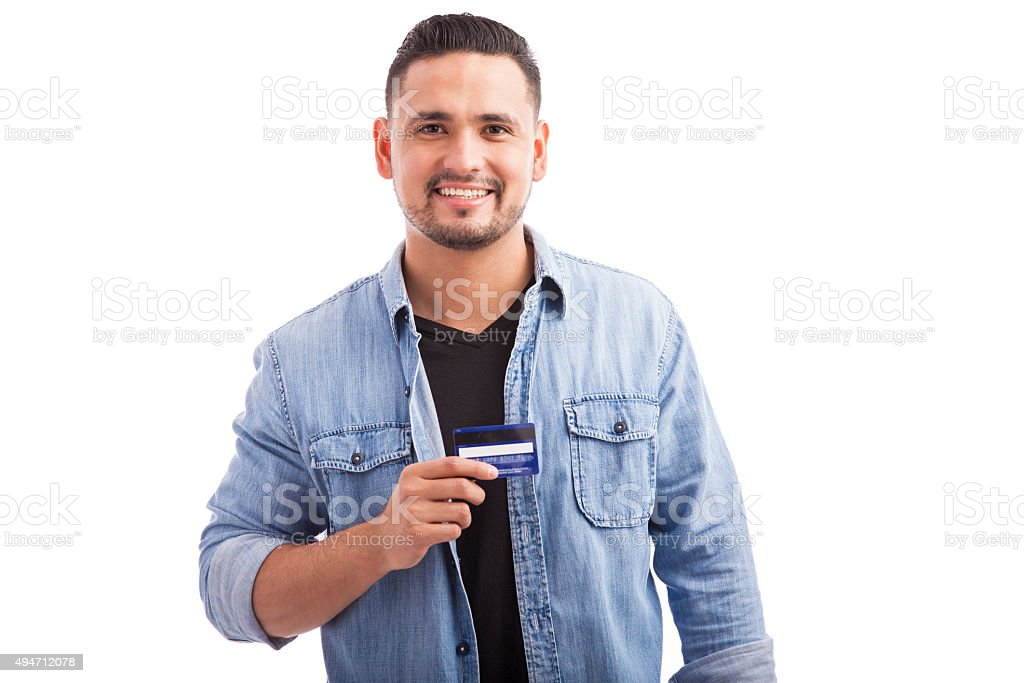 Happy young man with a credit card stock photo