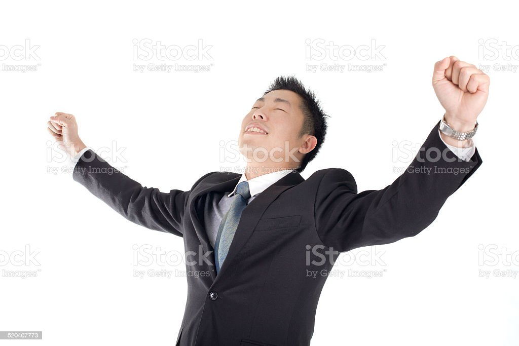 Happy young man with arms raised  isolated on white stock photo