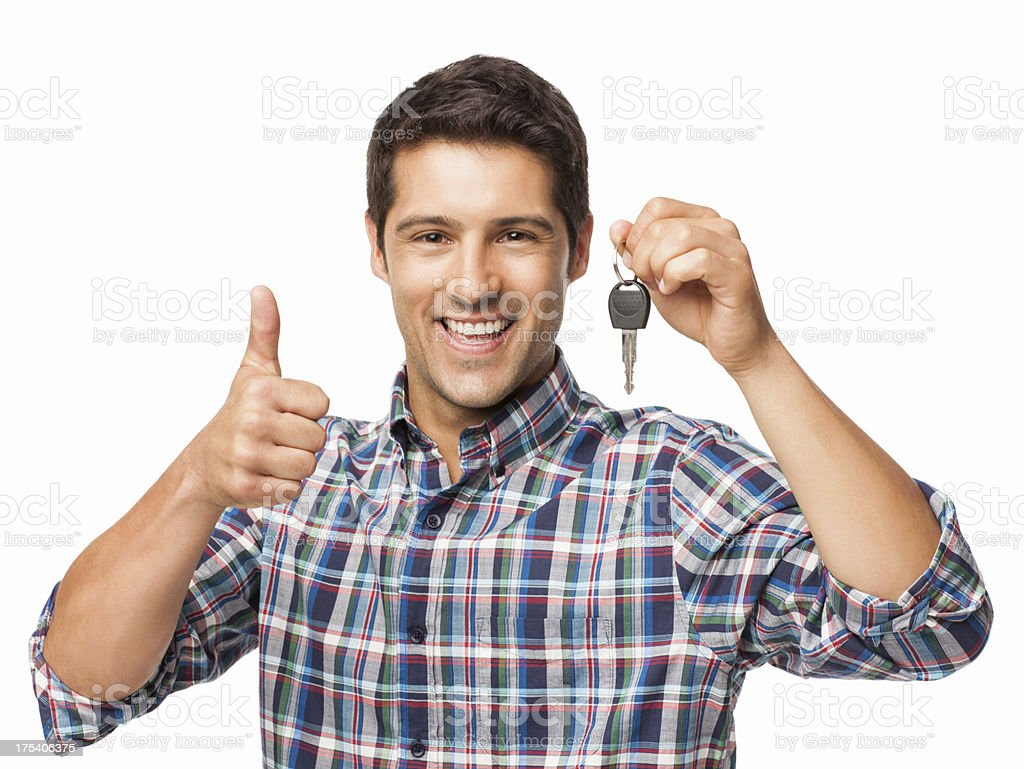 Happy Young Man With Car Key - Isolated stock photo