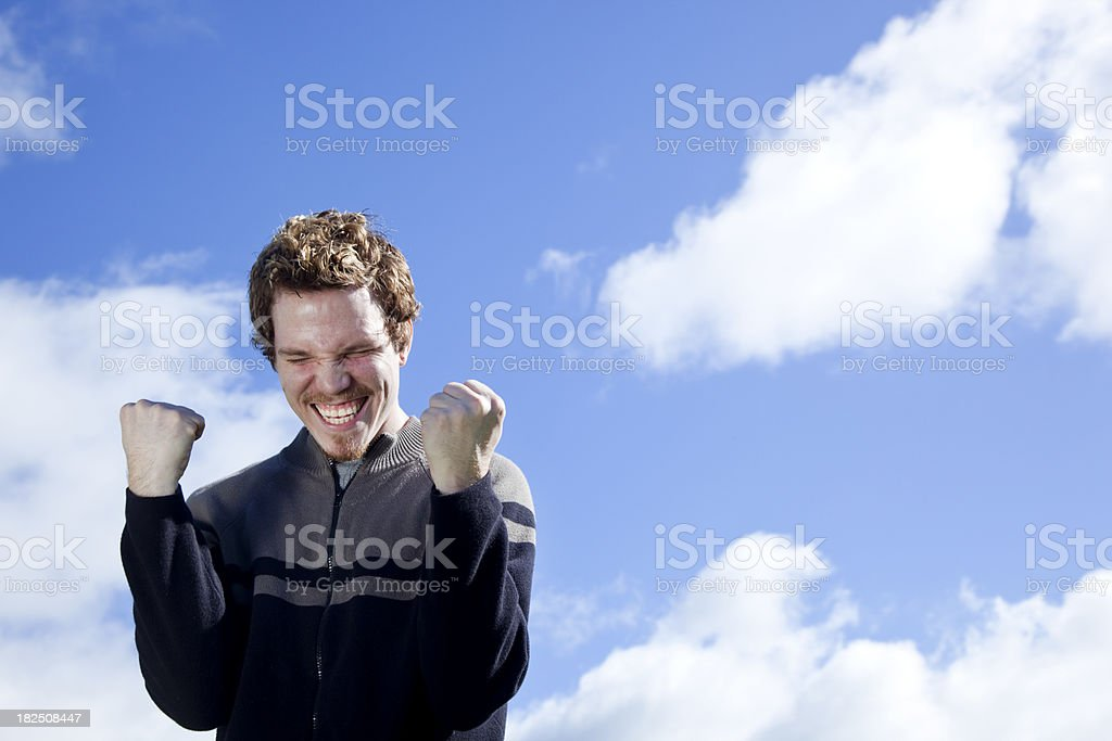 happy young man with fists in air royalty-free stock photo