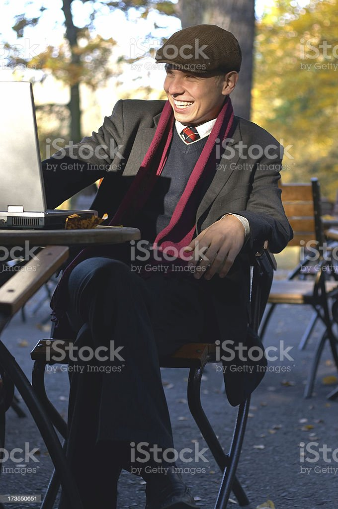 Happy Young Man with Laptop stock photo