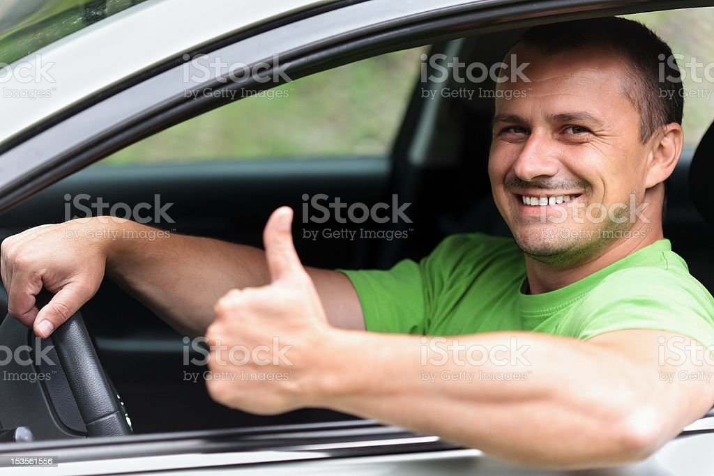 Happy young man with new car royalty-free stock photo