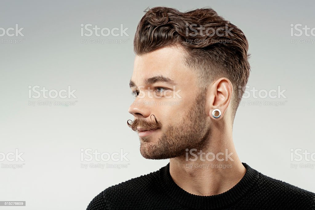 happy young man with waxed moustache stock photo