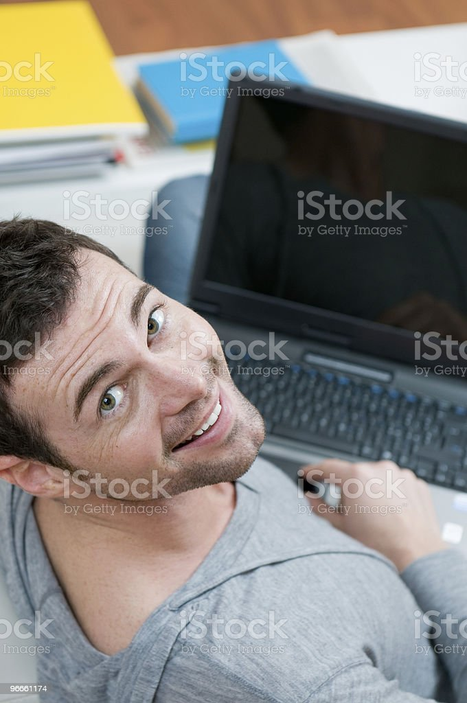 Happy young man working on laptop royalty-free stock photo