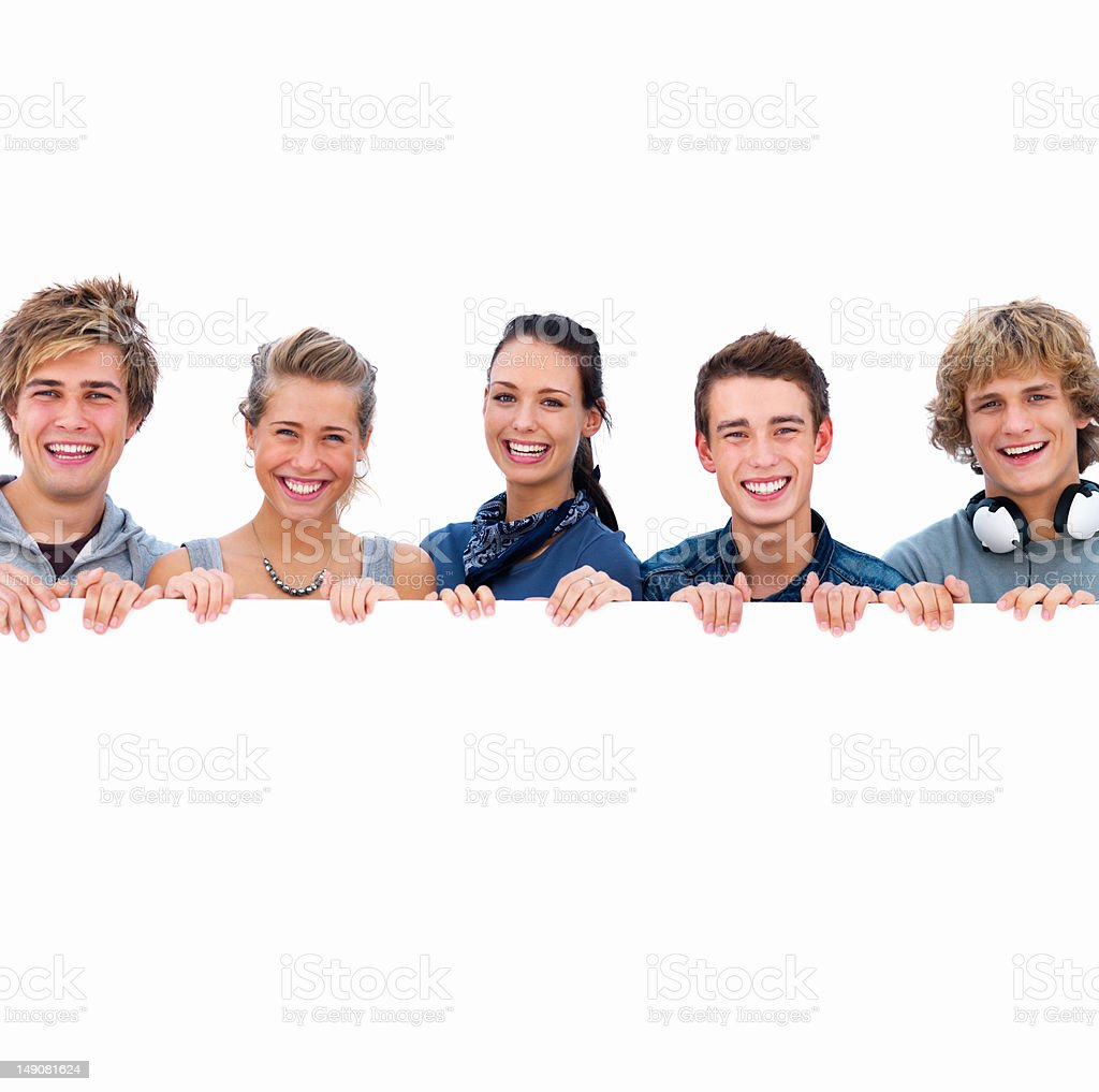 Happy young men and women behind a placard royalty-free stock photo