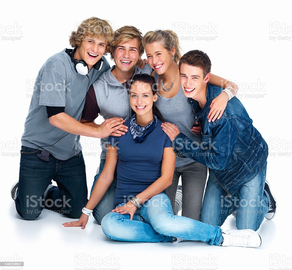 Happy young men and women sitting against white background royalty-free stock photo