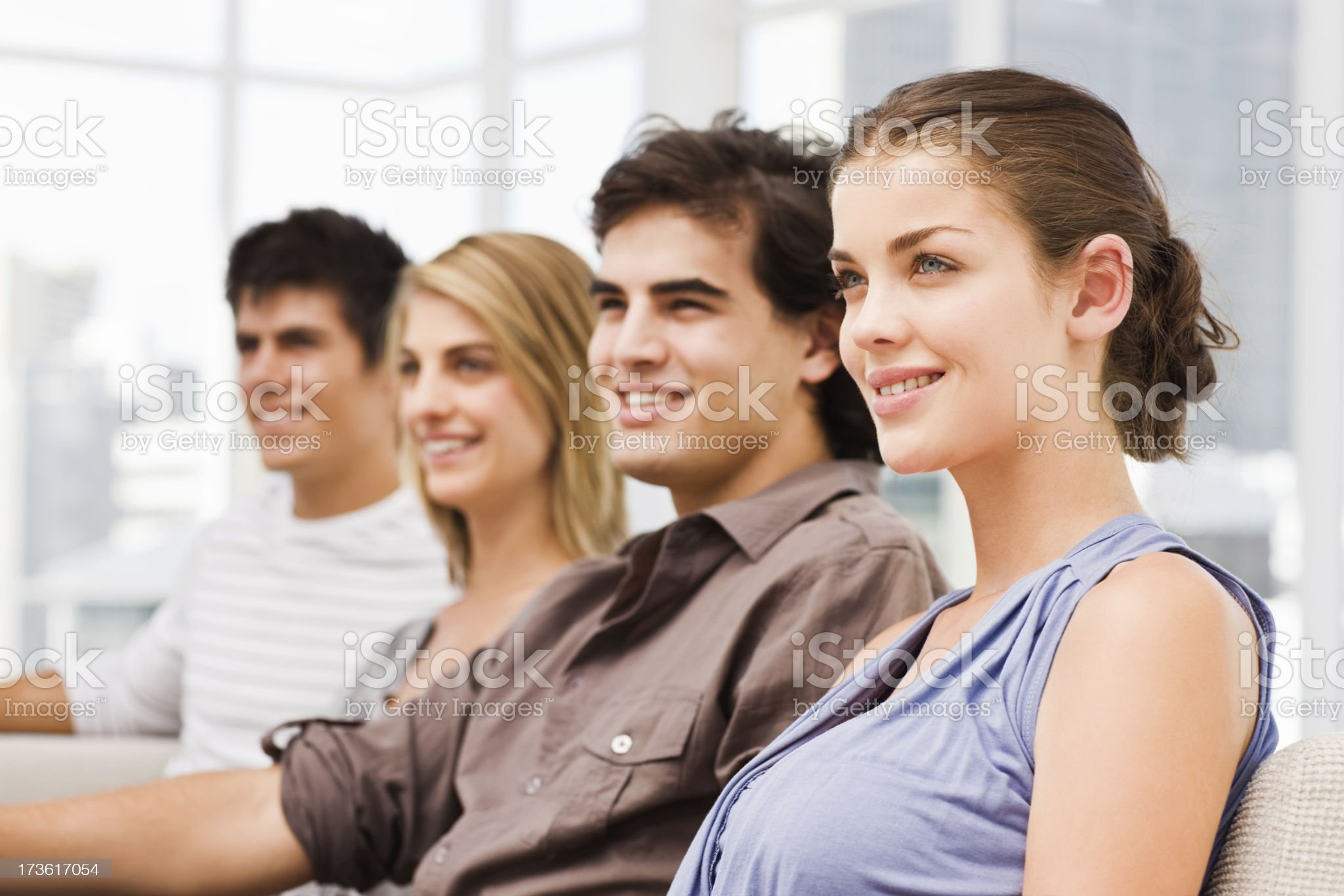 Happy young men and women sitting together royalty-free stock photo