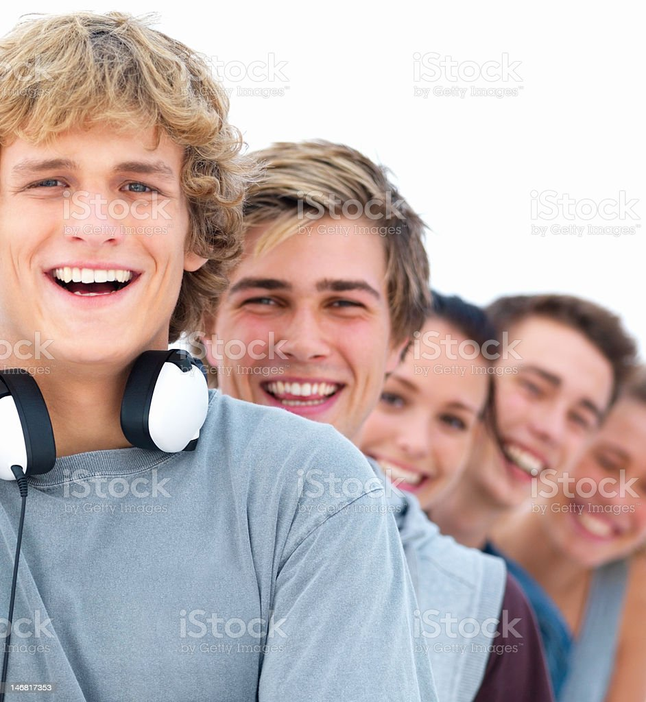 Happy young men and women standing in a line royalty-free stock photo