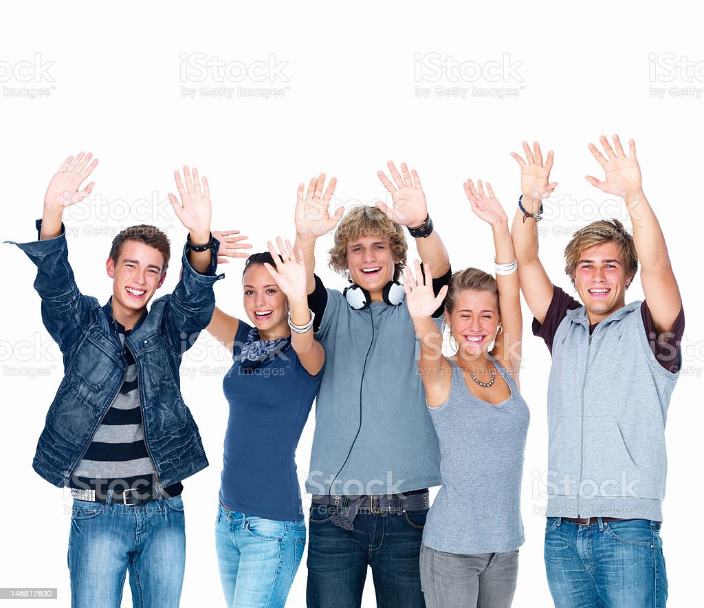 Happy young men and women with arms raised royalty-free stock photo