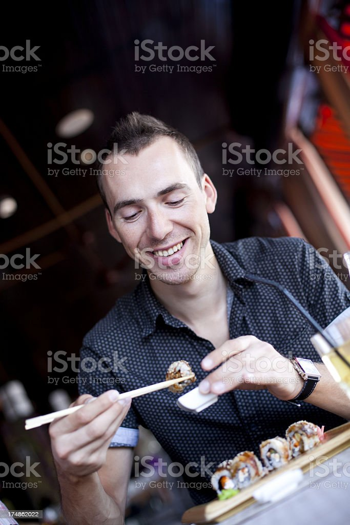 Happy Young Men Eating Sushi royalty-free stock photo