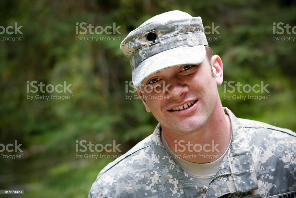 Happy young military man in uniform stock photo