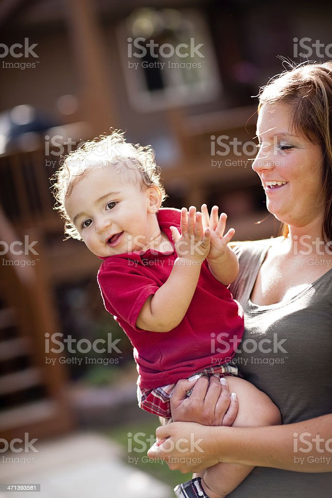 Happy, Young Mother Enjoying Her Toddler Son Outdoors stock photo