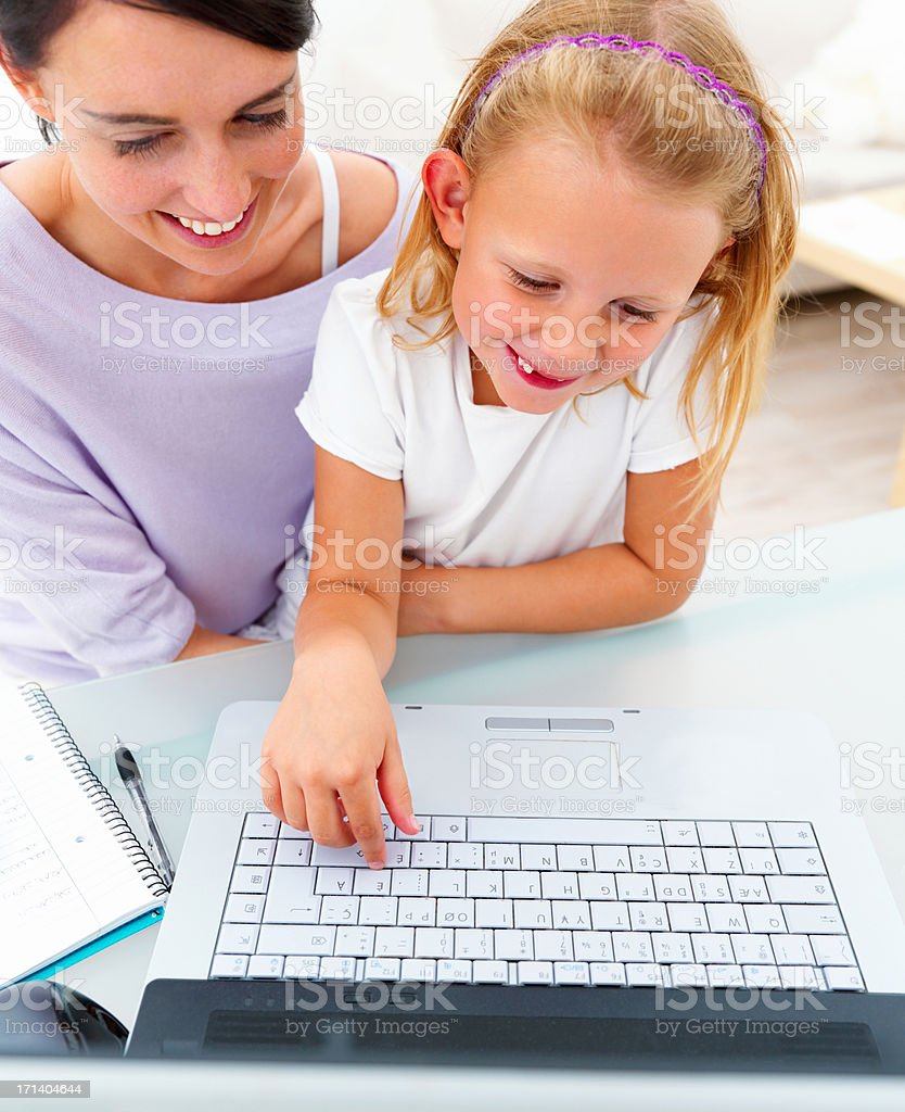 Happy young mother with her daughter using laptop royalty-free stock photo