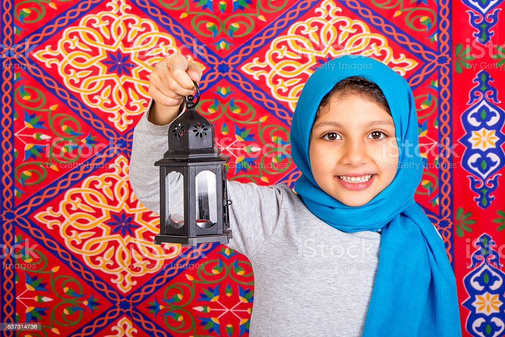 Happy Young Muslim girl celebrating Ramadan stock photo
