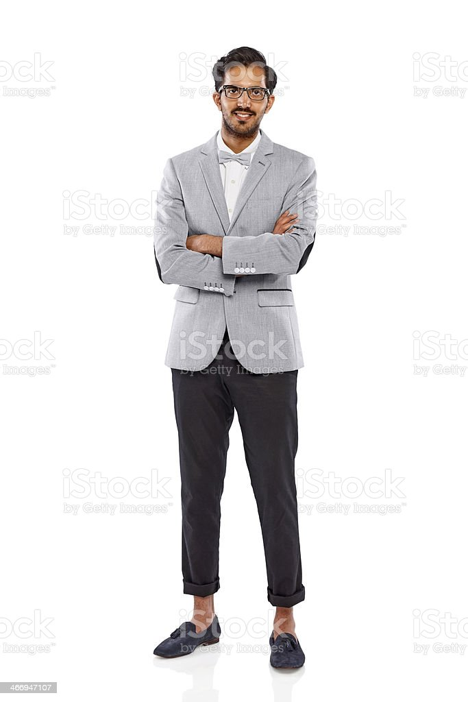 Happy young nerd standing with his arms crossed royalty-free stock photo