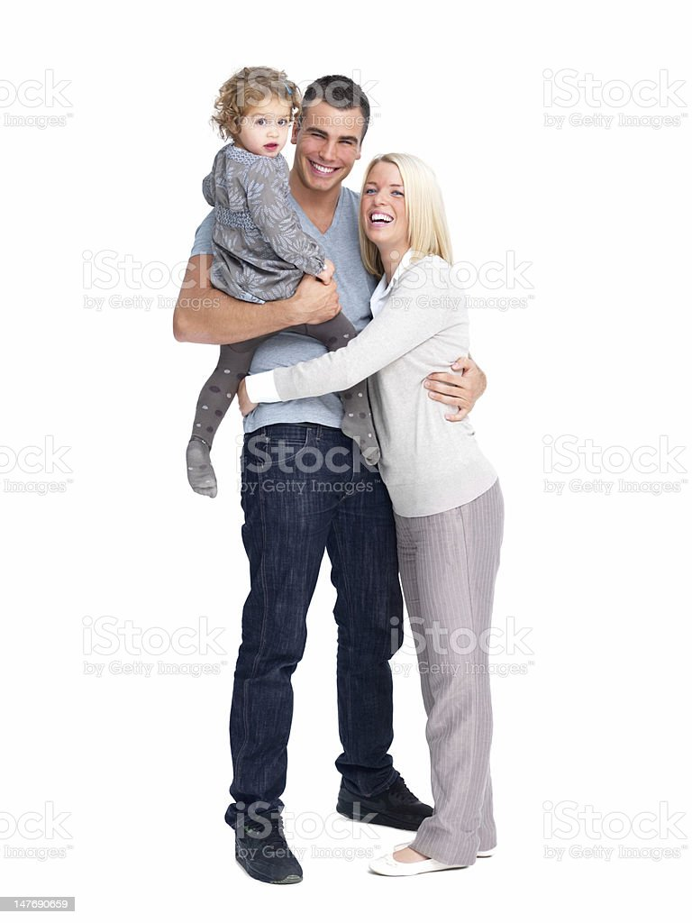 Happy young parents with daughter against white background stock photo