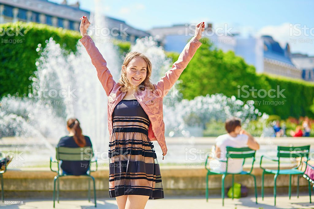 Happy young Parisian woman stock photo