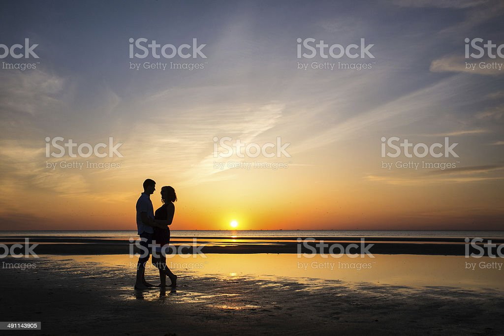 Happy young people at sunset royalty-free stock photo