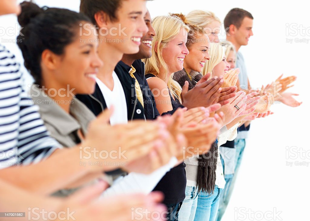 Happy young people clapping royalty-free stock photo