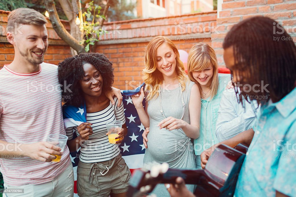 Happy Young People Dancing And Singing At Backyard Party. stock photo