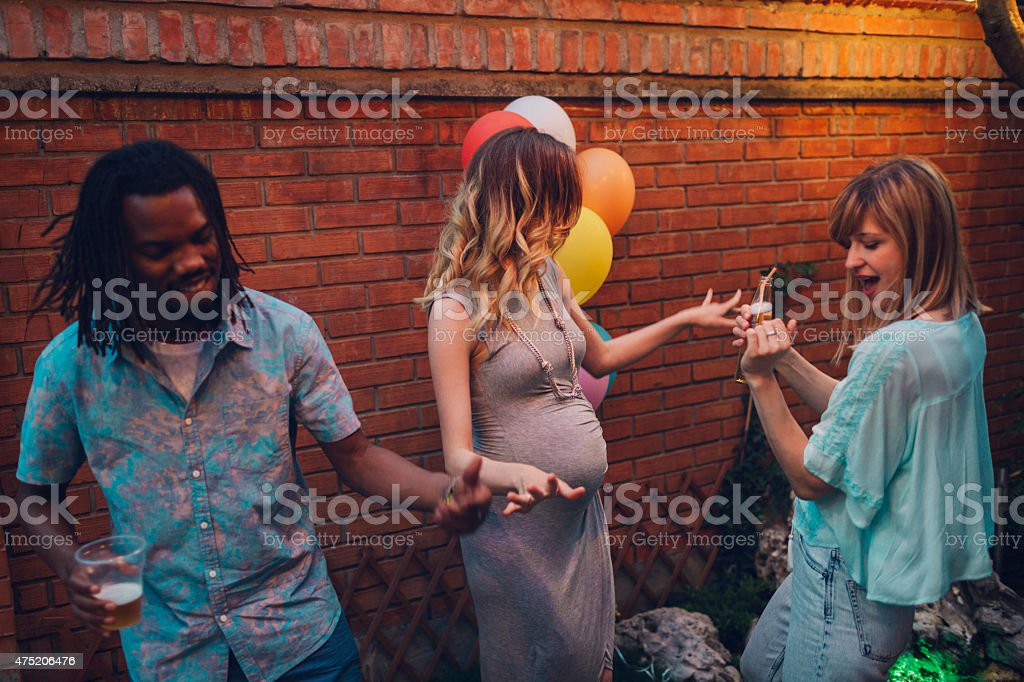 Happy Young People Dancing At Backyard Party. stock photo