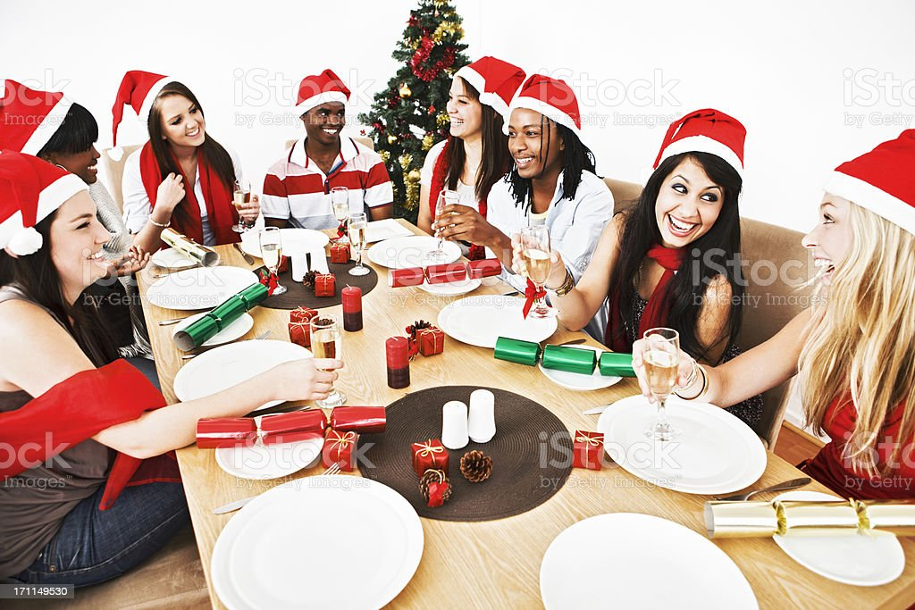 Happy young people share Christmas dinner royalty-free stock photo
