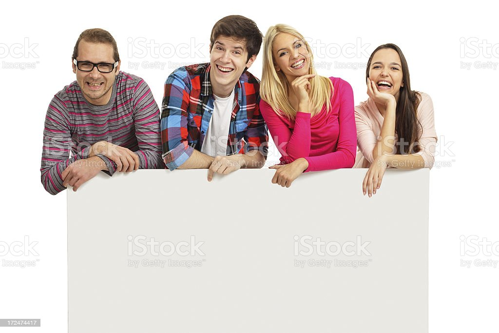 Happy young people with a banner royalty-free stock photo