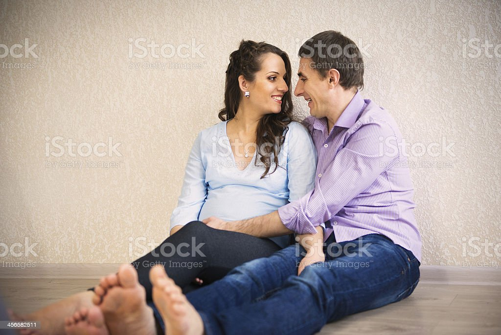 Happy young pregnant couple royalty-free stock photo