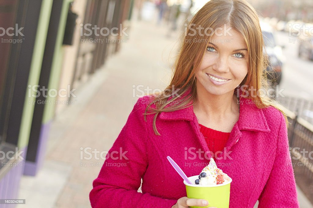 Happy Young Pretty Female Eating Frozen Yogurt royalty-free stock photo