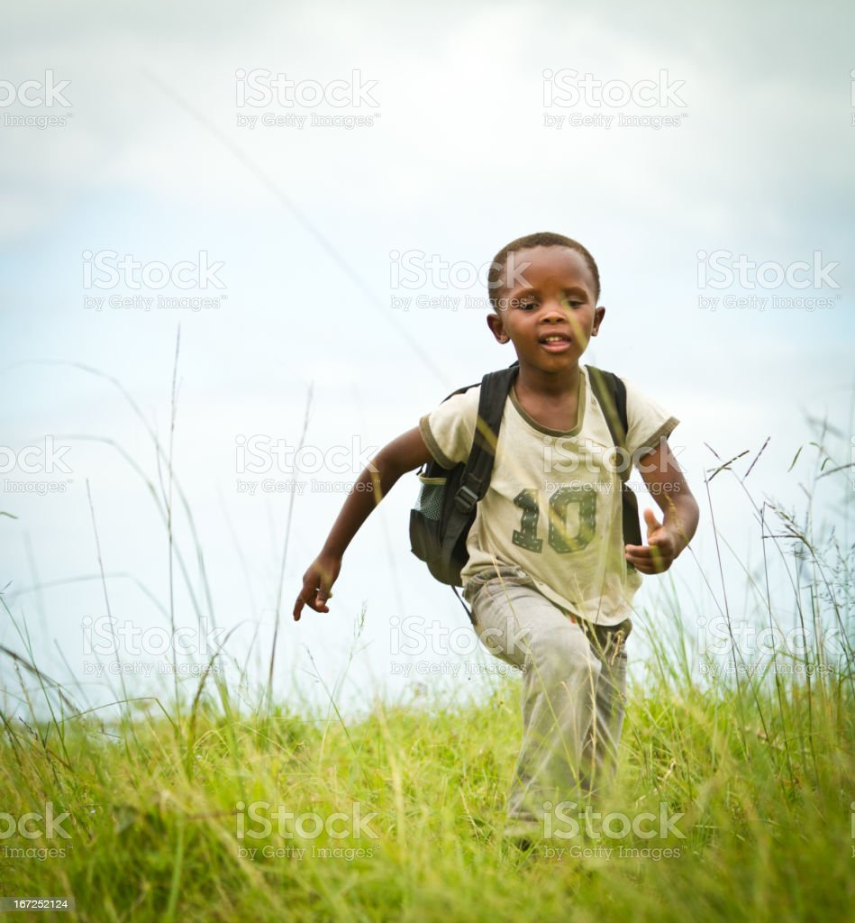 Happy Young South African Boy running to School stock photo
