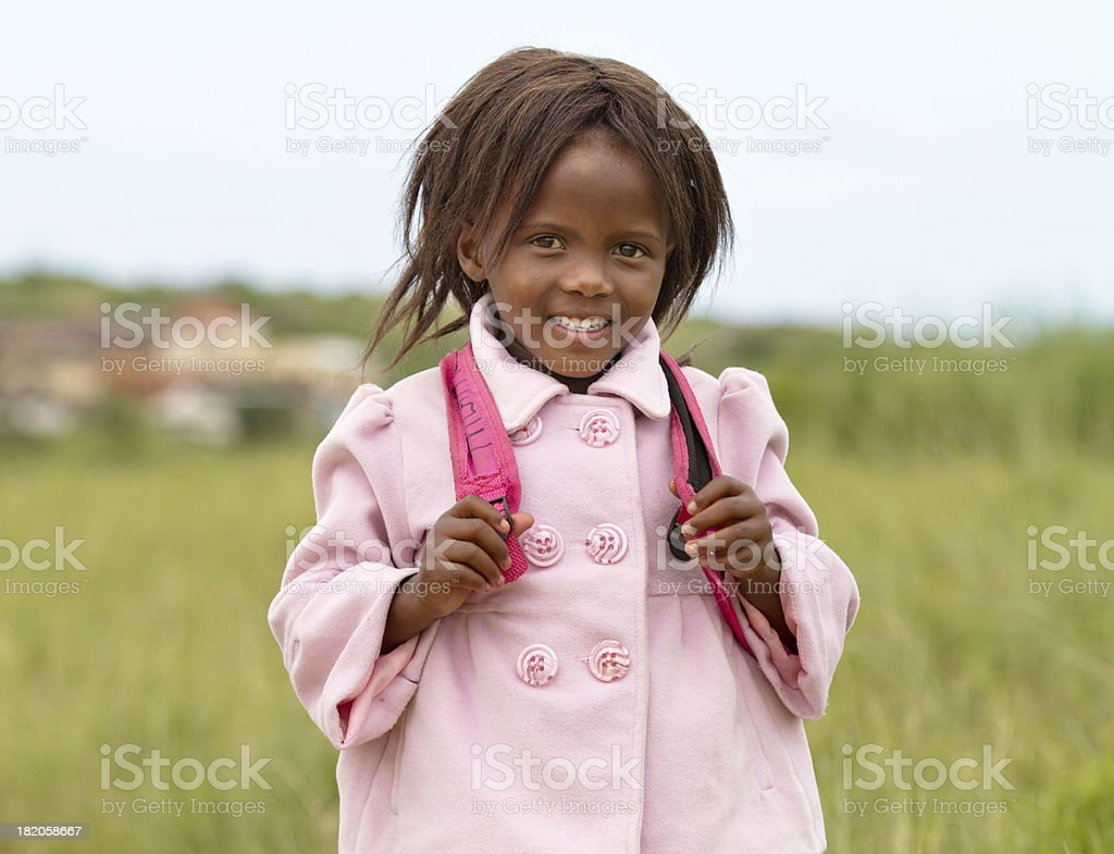 Happy Young South African girl on her Way to School stock photo