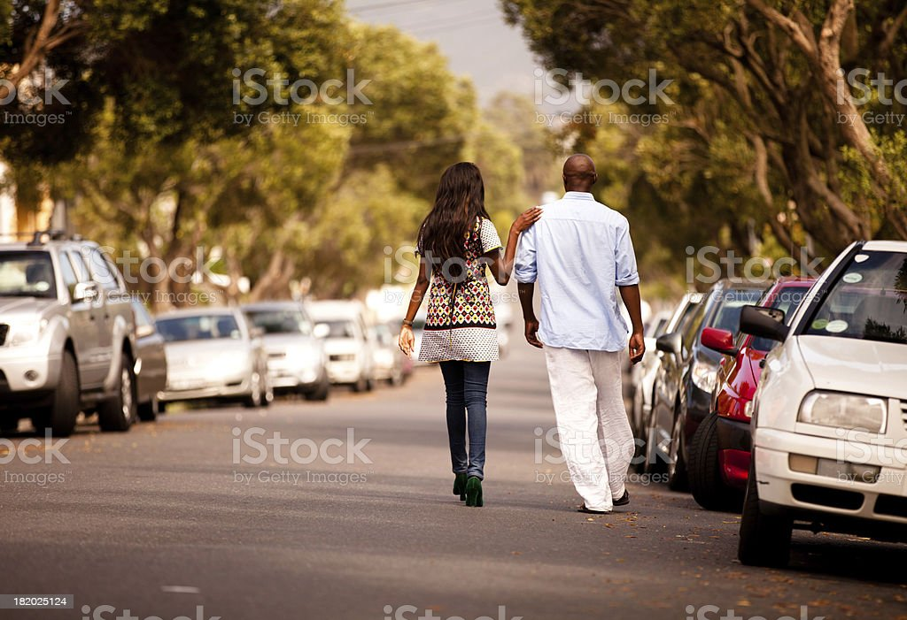 Happy young South African Xhosa couple in love walking stock photo