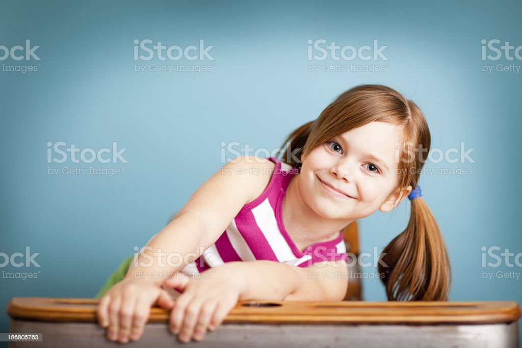 Happy Young Student Girl in School Desk royalty-free stock photo