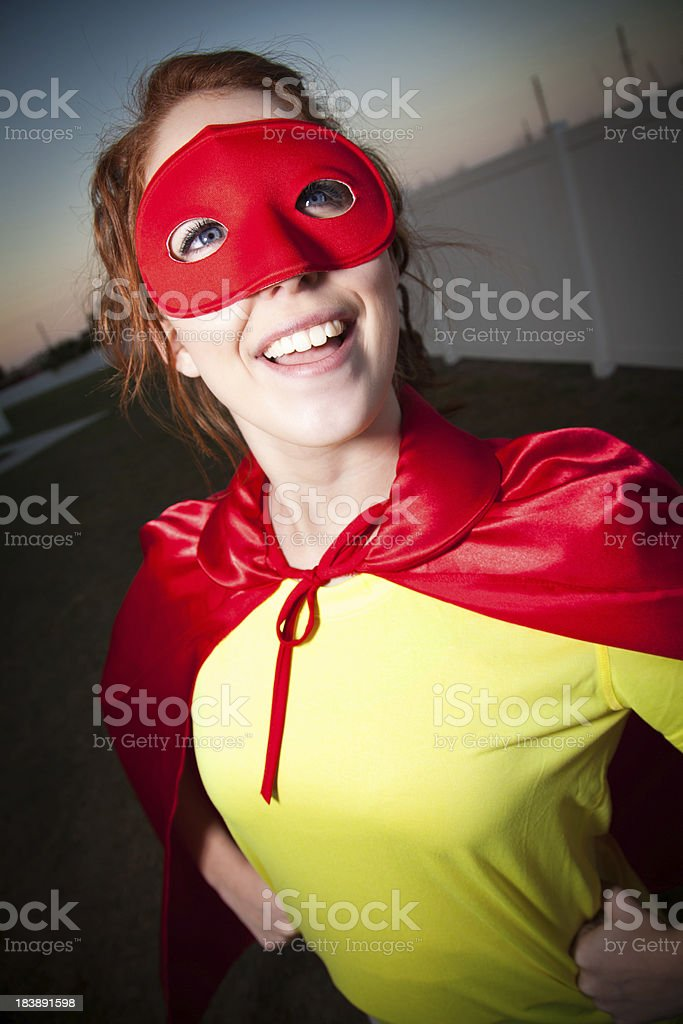 Happy Young Superhero Looking Up royalty-free stock photo