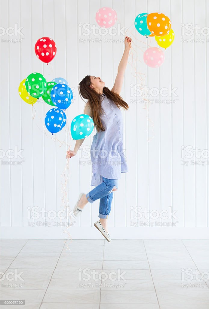Happy young teen girl with helium air balloons stock photo
