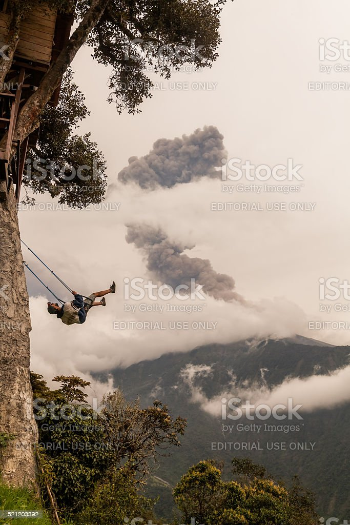 Happy Young Teenager Boy Swinging On A Tree House Swing stock photo