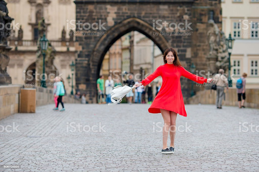 Happy young urban woman in european city on the famous stock photo