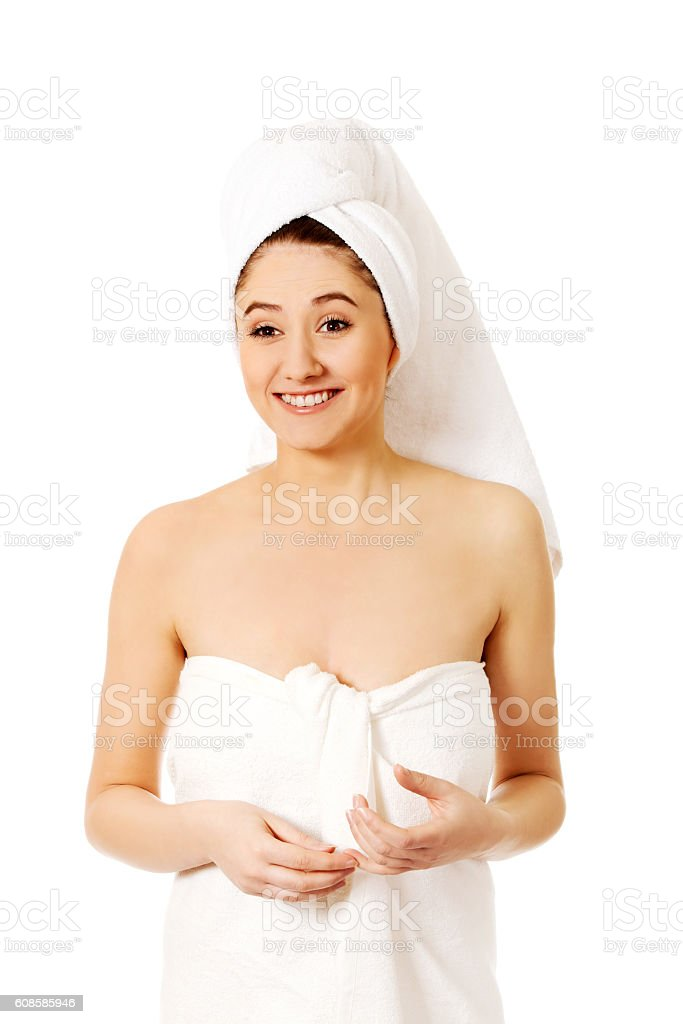 Happy young woman after bath or spa stock photo