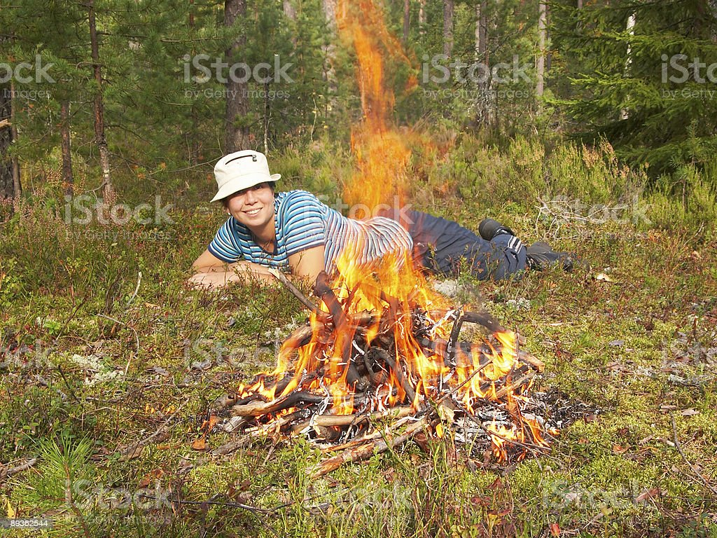 Happy young woman and campfire royalty-free stock photo