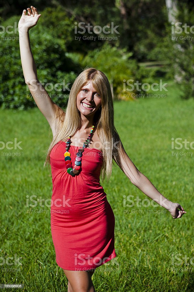 Happy young woman at the park, spring season. royalty-free stock photo