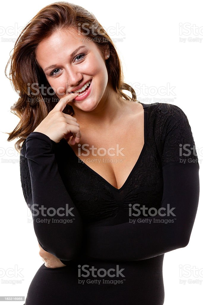 Happy Young Woman Bites Finger royalty-free stock photo