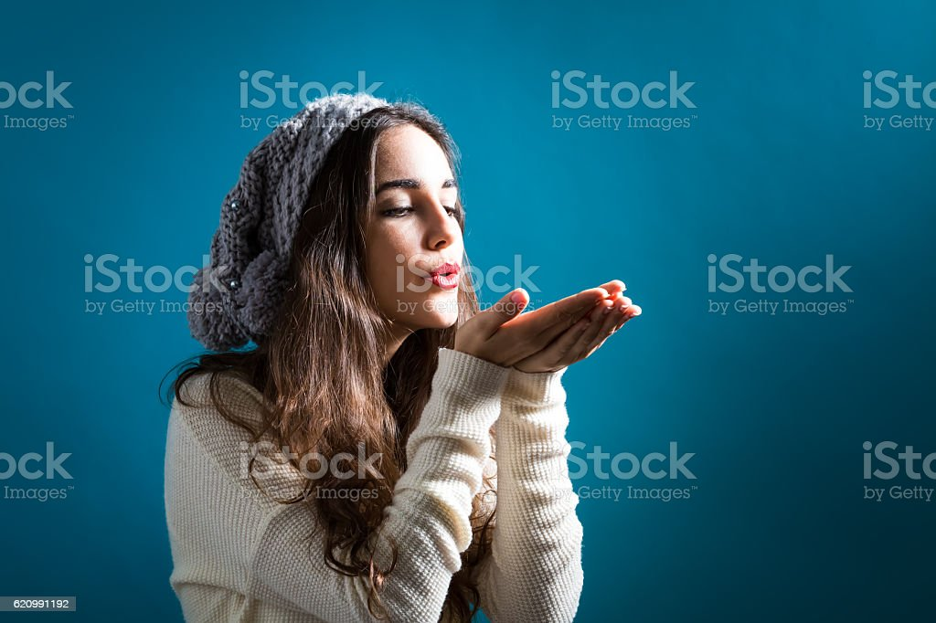 Happy young woman blowing a kiss stock photo