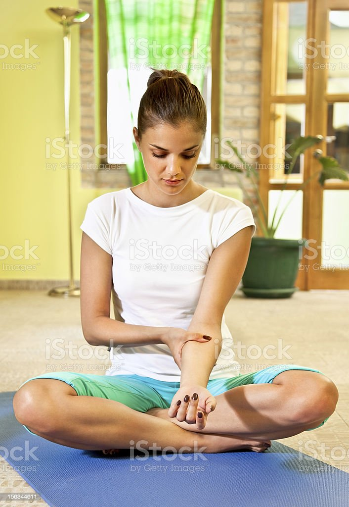 Happy young woman doing  arm self massage at home. royalty-free stock photo