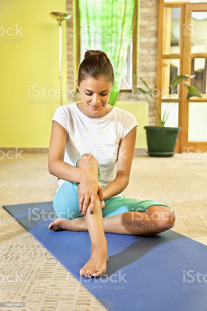 Happy young woman doing self massage at home. royalty-free stock photo